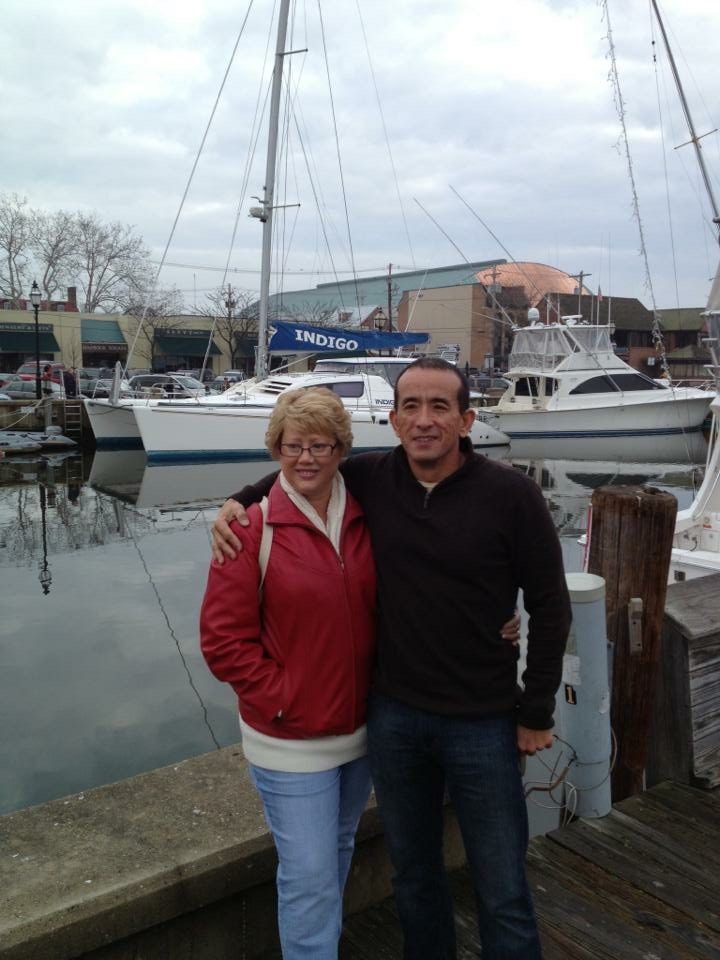 Jim & Betsi in Annapolis, MD with our new to us sailing catamaran INDIGO in the background