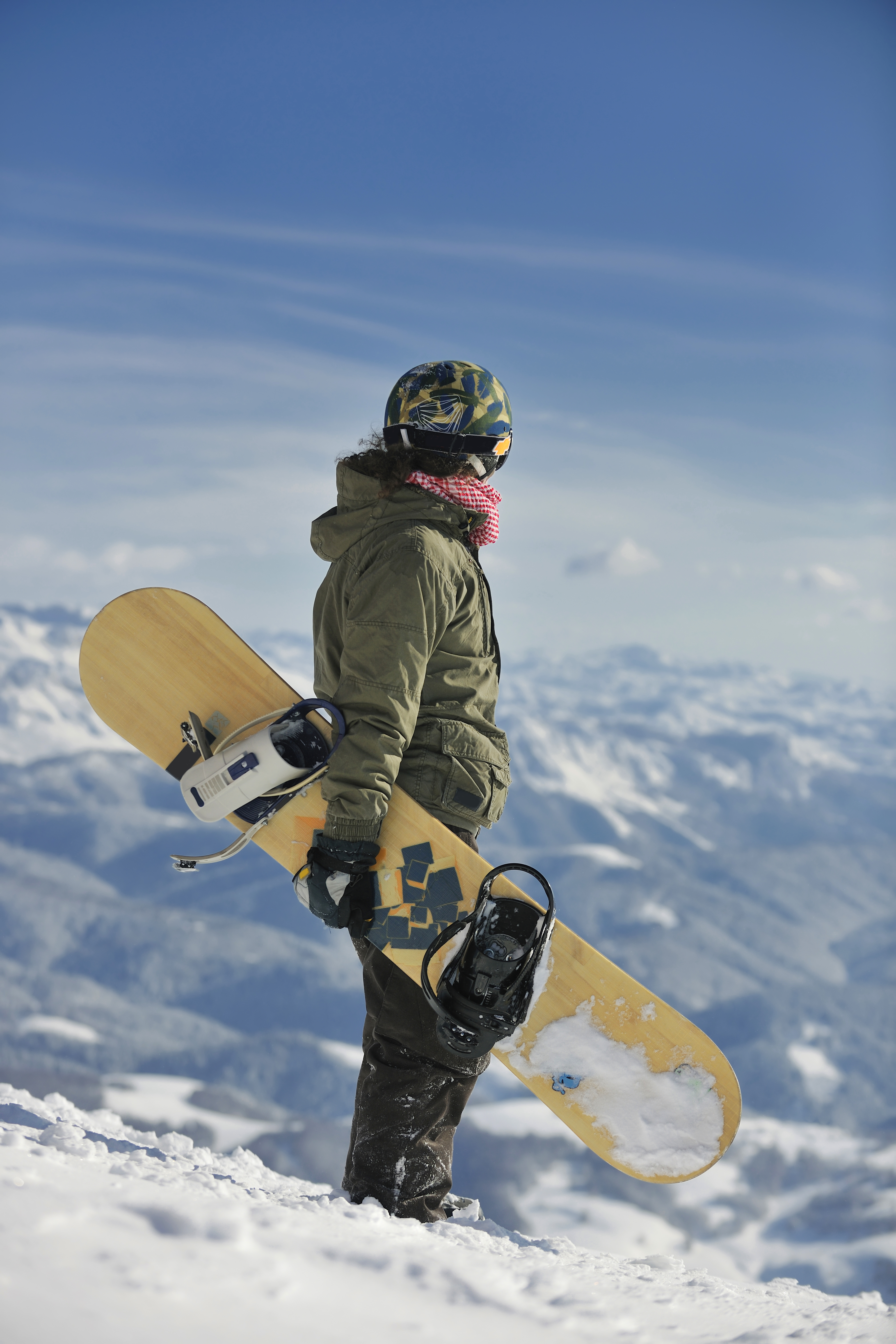 Try your hand snowboarding at four resorts in Québec City. Here a snowboarder is relaxing on a sunny day.