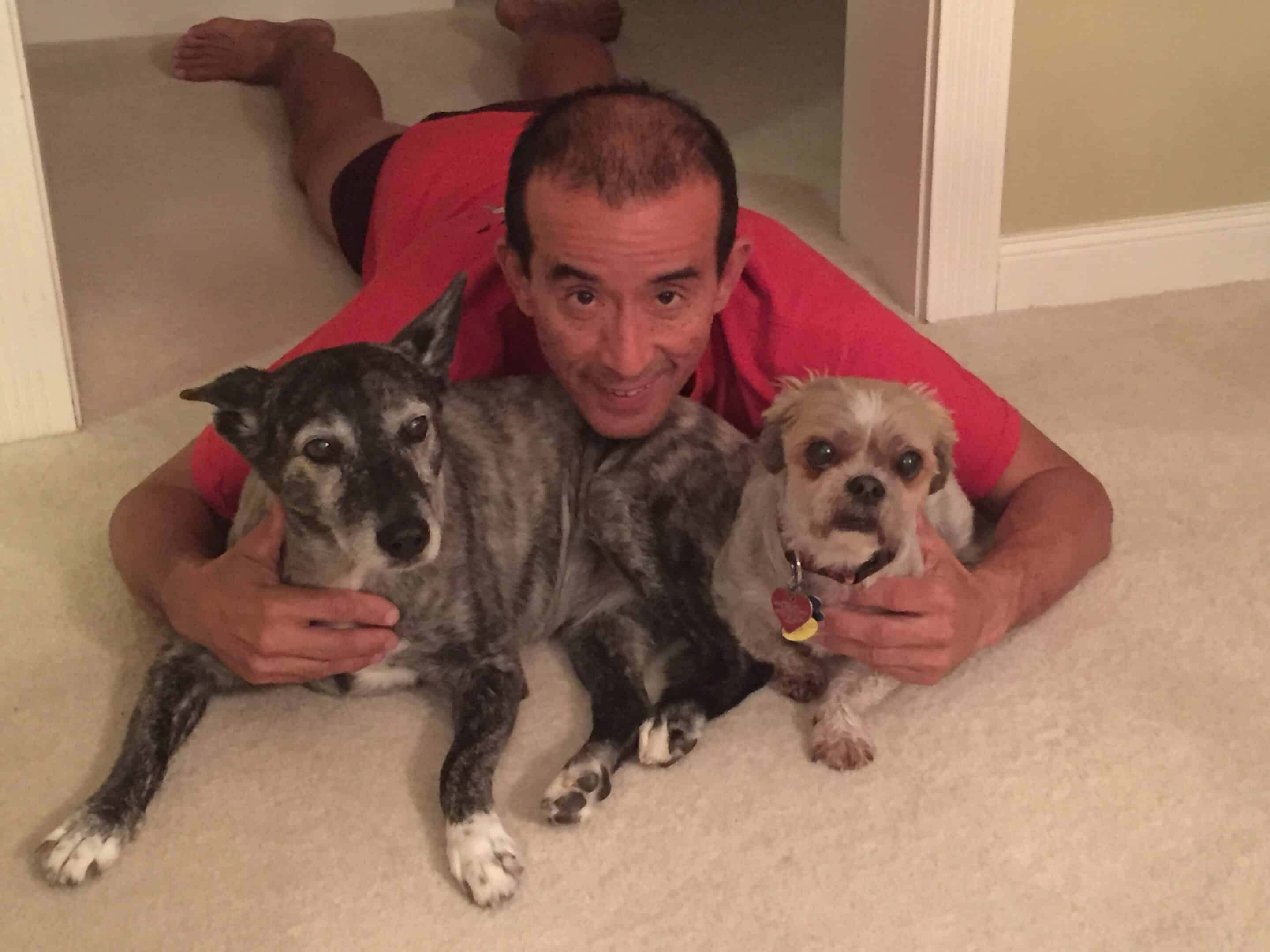 Kiwi, our beloved dog, with Bentley, her brother, and Jim