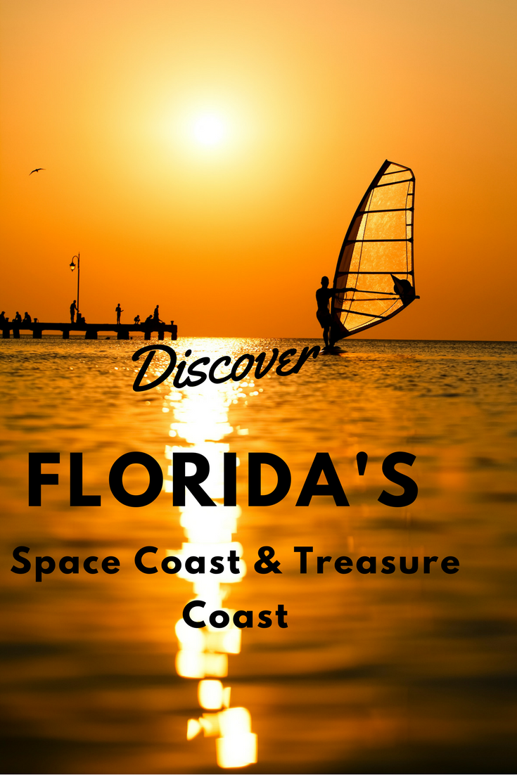 Discover Florida's Space Coast & Treasure Coast: Cocoa Beach: Man passing by with his windsurf or sailboard at sunset on a calm ocean against a spectacular vivid orange sky