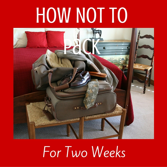 Red sofa in background, green suitcase & carryon with clothes spilling out