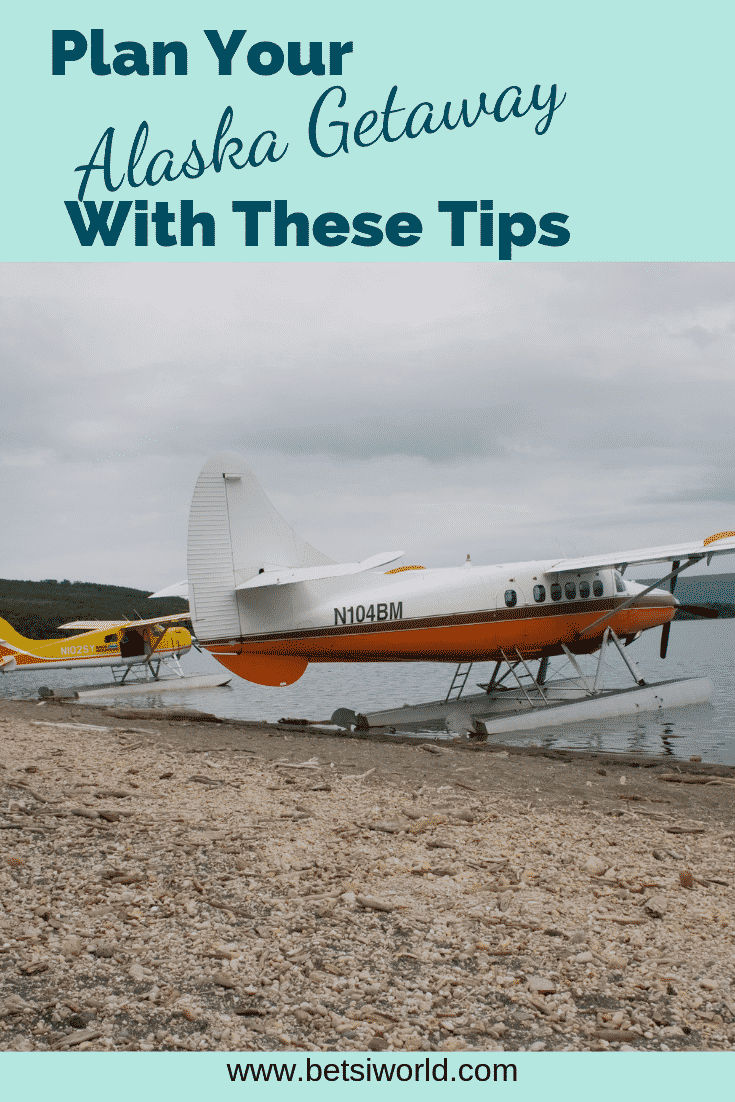 Seaplanes are an easy way to see Alaska. White and orange sea plane on the rocky beach