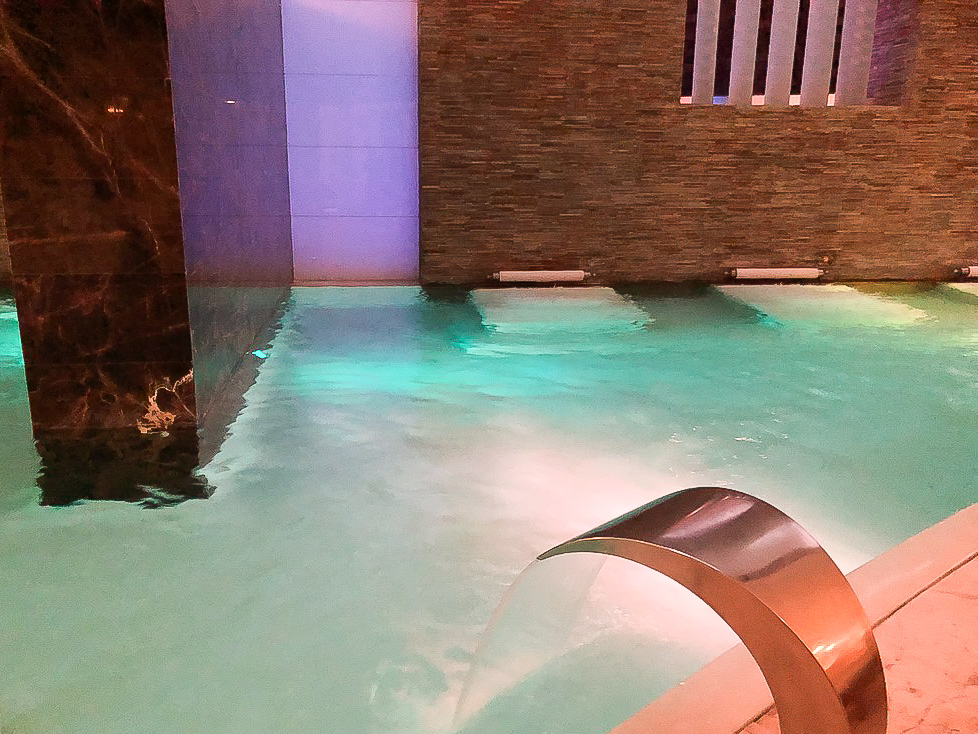 Blissful relaxation under the waterfalls at Grand Velas Se Spa Water Ceremony's Sensation Pool