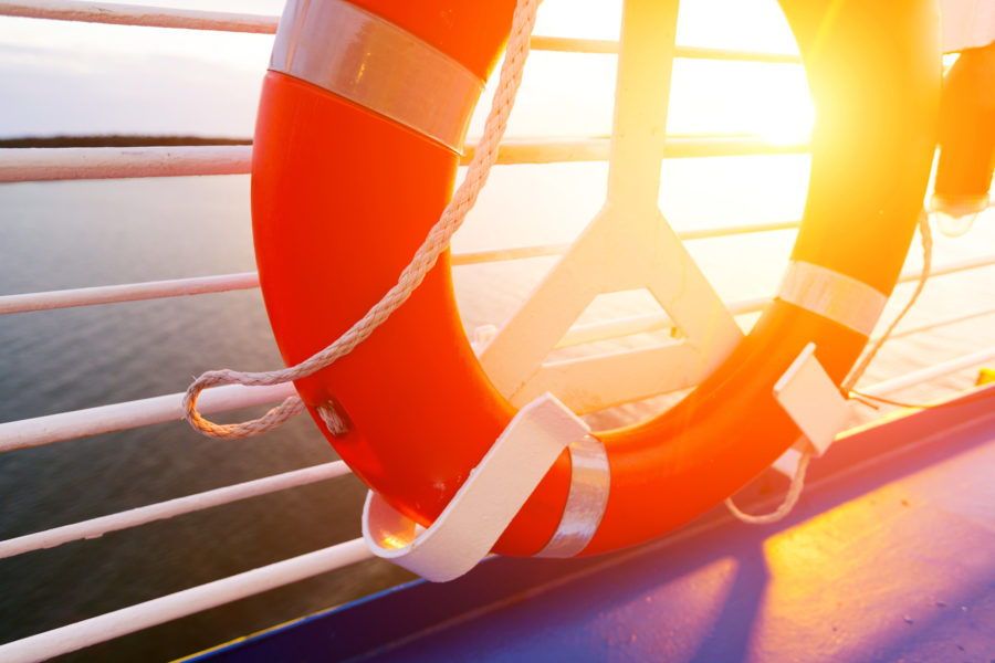life ring on boat deck with sun streaming in