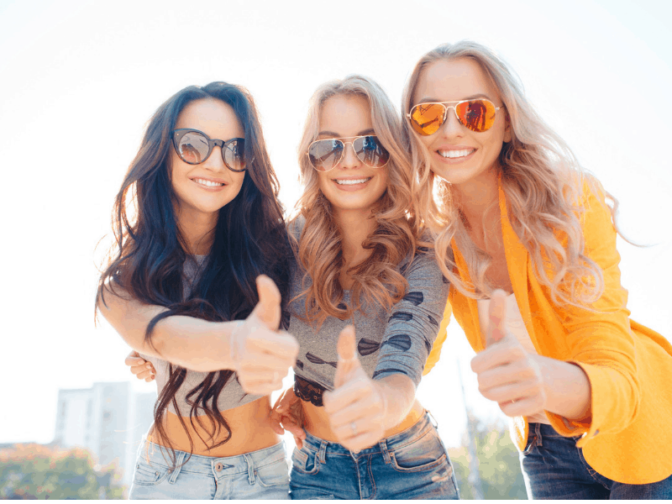 3 girls, wearing sunglasses with a thumbs up