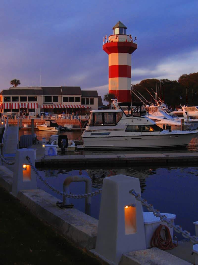 red and white lighthouse at Hilton Head, South Carolina. dusk. hotel and marina. A beautiful place for an affordable romantic getaway