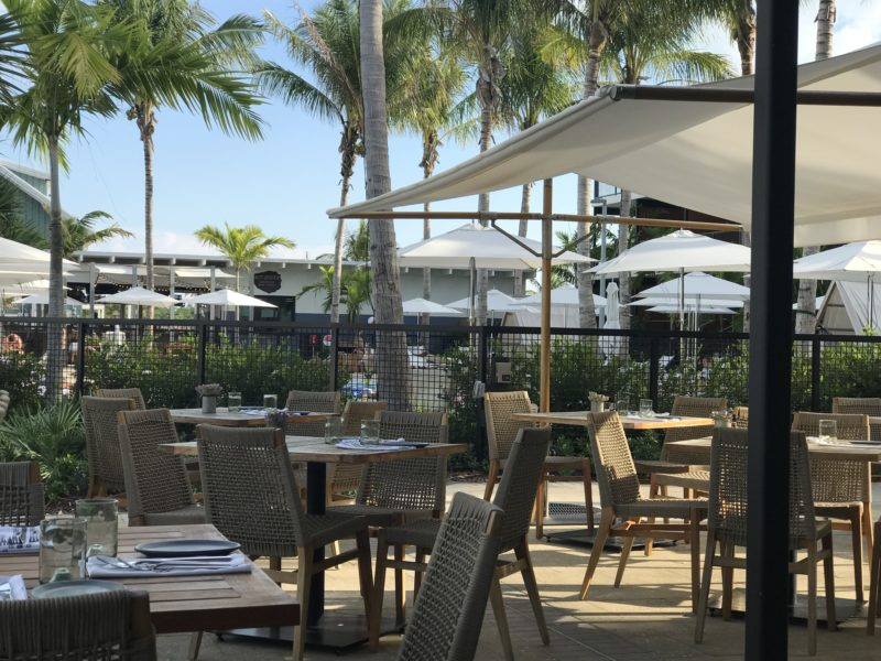 Outdoor dining at Matts Stock Island Kitchen overlooks the water, and is shaded by market umbrellas