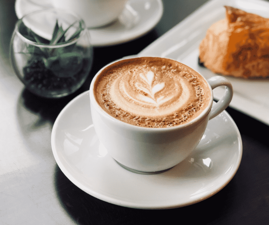 A delicious cup of coffee on a table ready to be enjoyed.