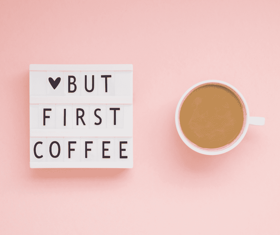 A top down view of a coffee cup and a cute sign great ideas for gifts for the coffee addict
