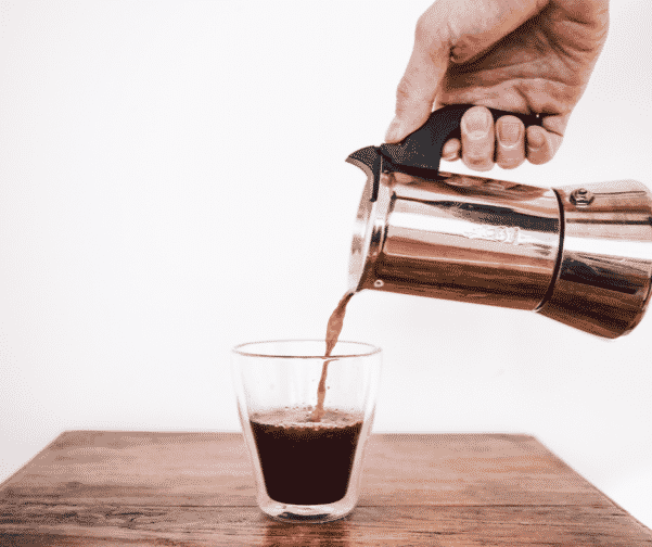A gorgeous coffee accessory pouring a great cup of coffee at home to save money