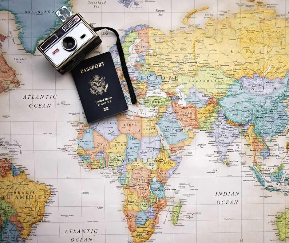 Featured image showing a map and passport with a camera