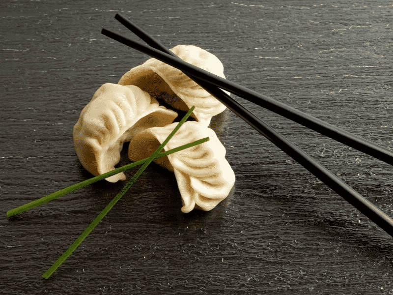 dimsum with chopsticks on wood table