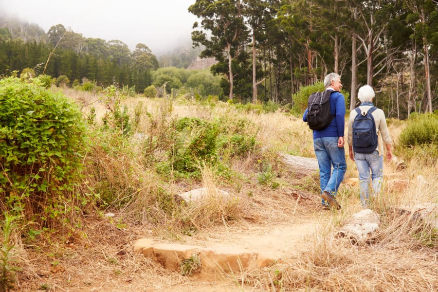 a couple hiking in fall, an example of what to do on your romantic midlife adventure getaway