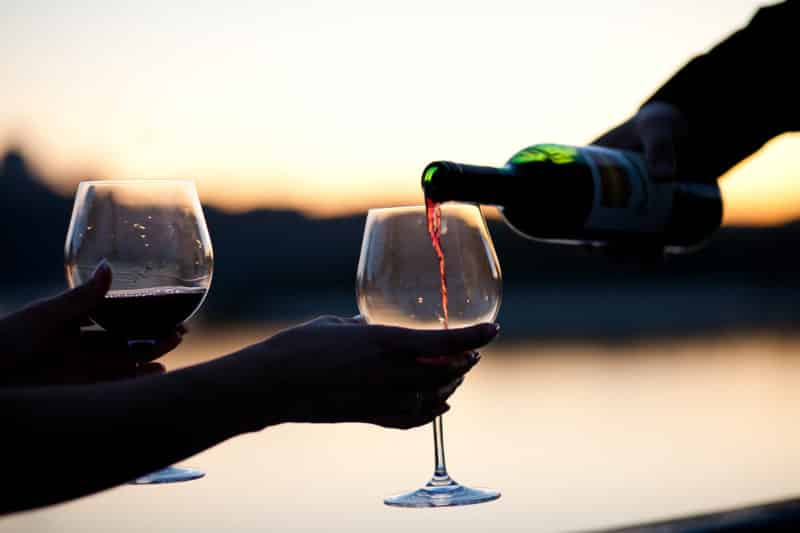 wine glasses with a sunset backdrop to represent a vineyard. A great idea for a romantic adventure getaway.