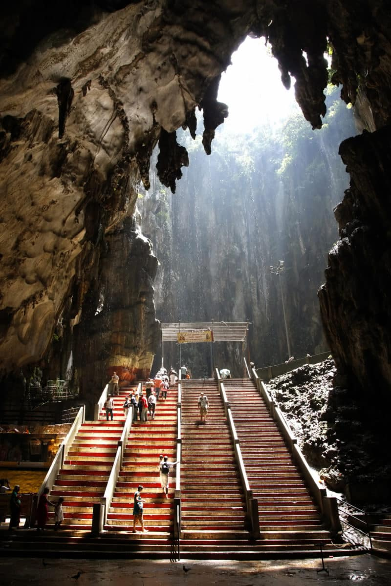 Ancient Batu Caves in Malaysia having a hindu temple inside.