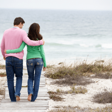 couple on the beach enjoying a romantic beach getaways in the south