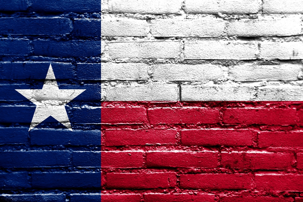 Texas flag painted on the brick wall.