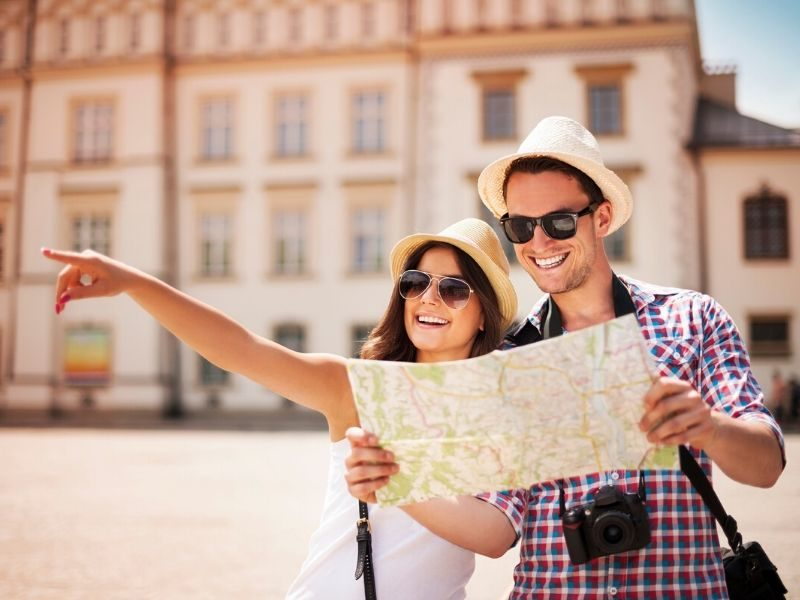 couple looking at map in city