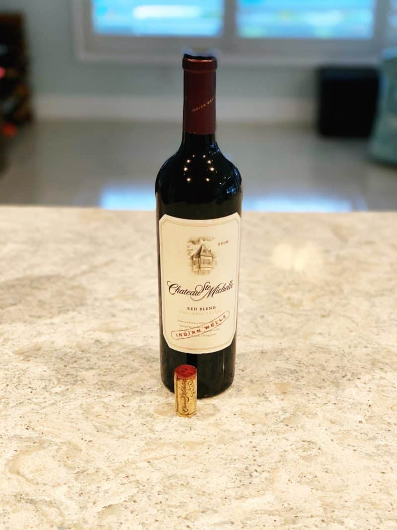 bottle of red wine sitting on countertop