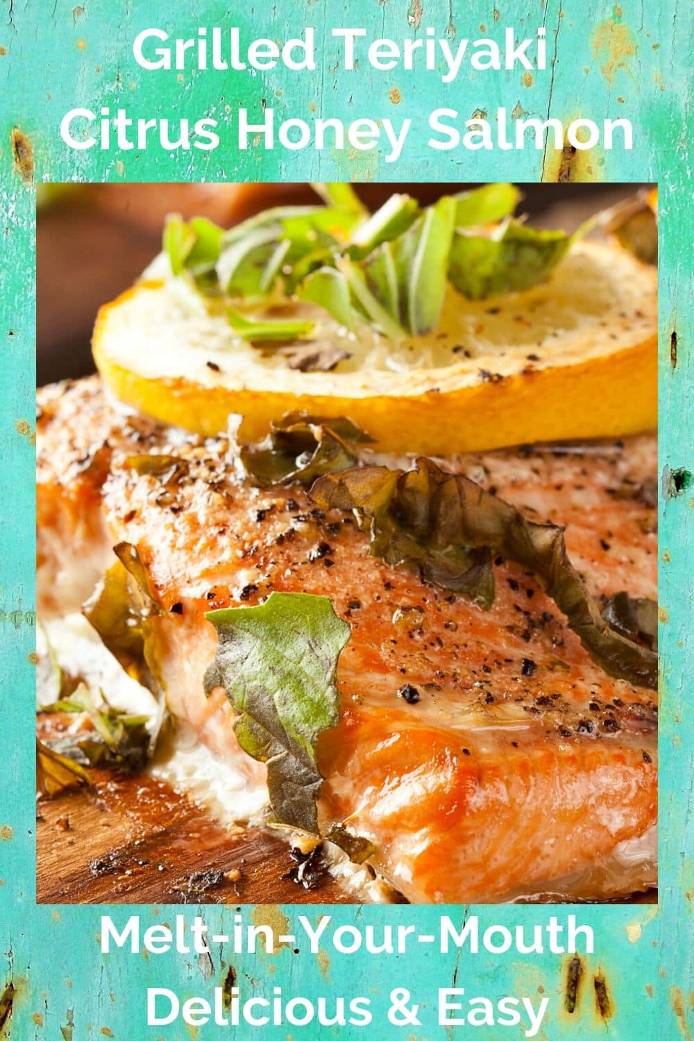 distressed wood background with fillet of grilled citrus salmon topped with lemon slices