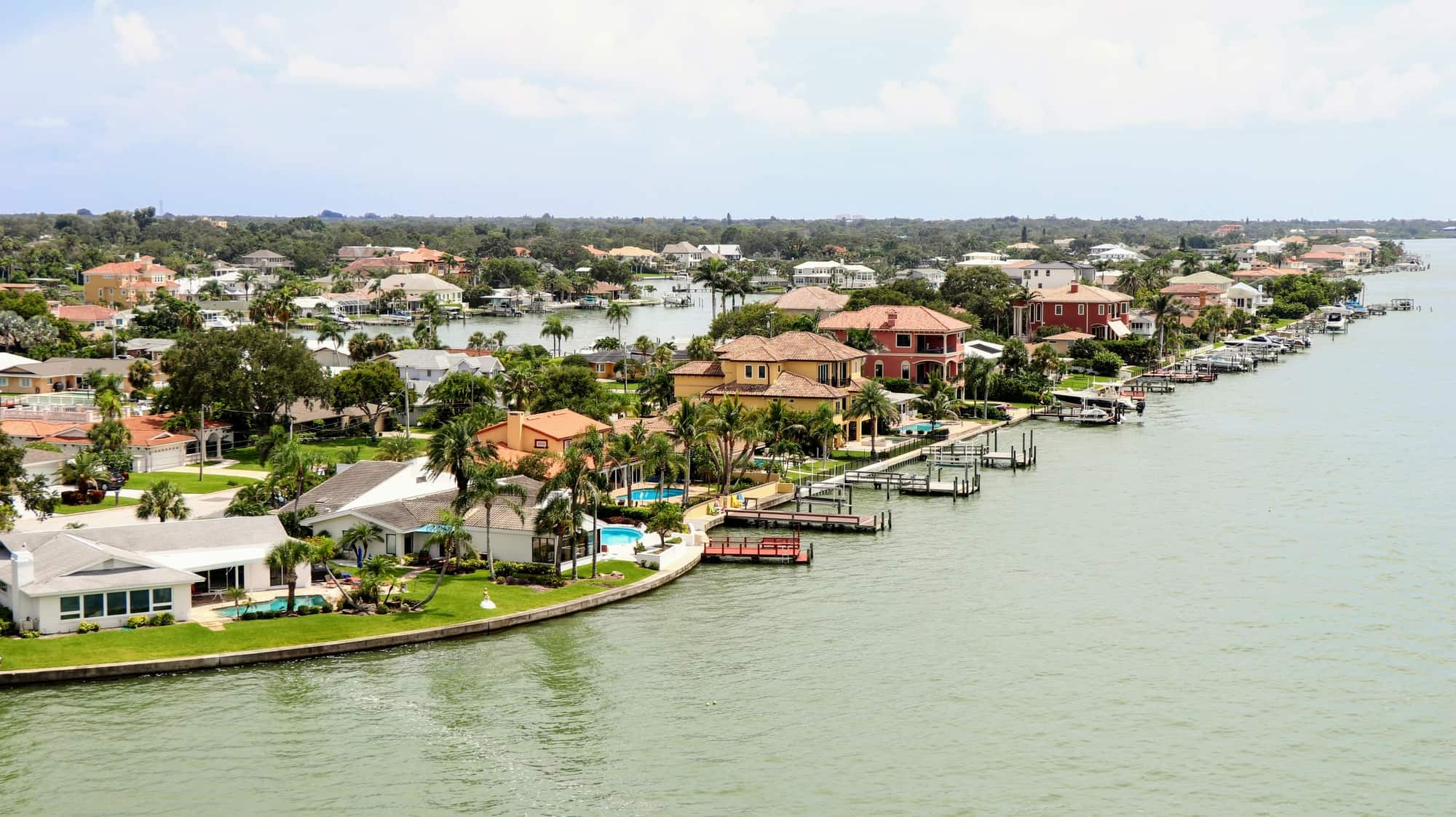 The luxury houses of Belleair, out the the bay with boats and private piers in front