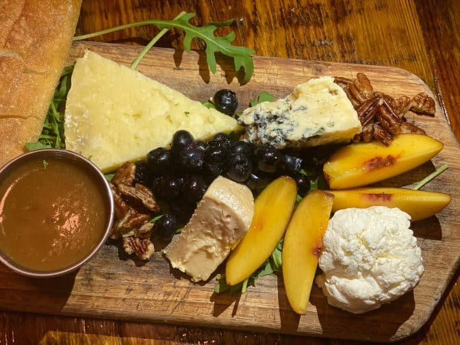 Charcuterie tray from The Floridian includes a variety of cheeses, nuts, honey, and fruits
