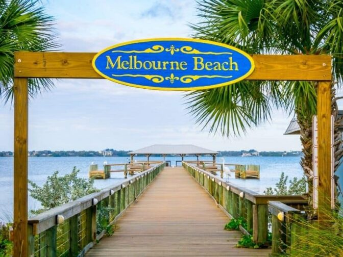 Melbourne Beach sign over beach walkway. Melbourne is one of the destinations that we love for the best romantic Florida getaways