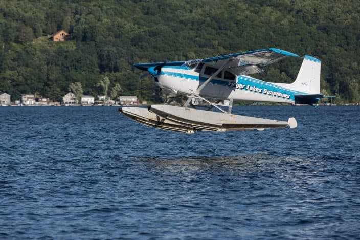 Seaplane taking off from the lake in the Finger Lakes, NY