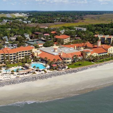 Aerial photo of the King and Prince with its standout red tile roofs. This mediterraen style coastal GA resort is perfect for weekend getaways