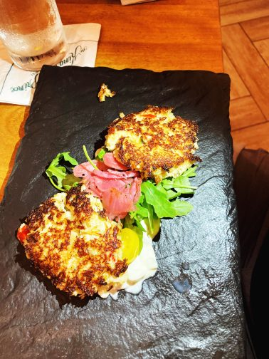 crab cakes on a slate platter