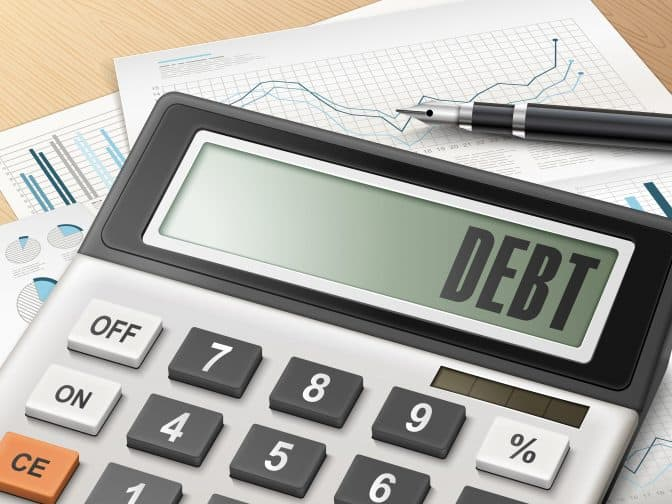 a calculator with the word debt on it to calculate all of your debt repayments
