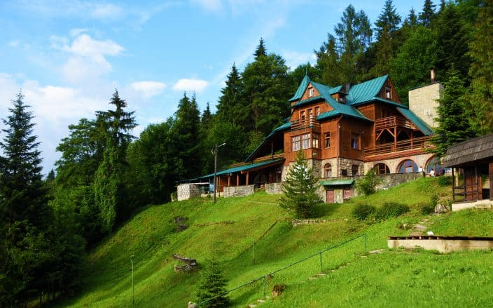 large cabin in the mountains with blue skies the perfect place to vacation