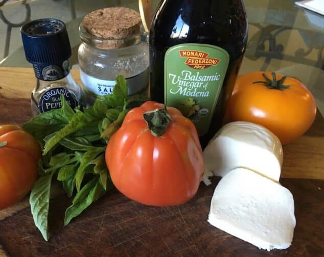 caprese salad ingredient. Balsamic vinegar, tomatoes, mozzarella cheese, salt and pepper, and basil.