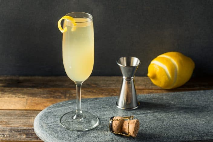 oozy Refreshing French 75 Cocktail with Lemon and Champagne, part of ways to celebrate New Years Eve at home.