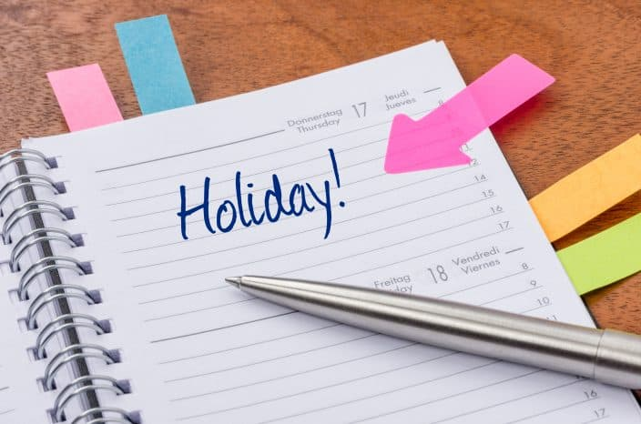 a daily planner with your holiday scheduled so you can pack in advance