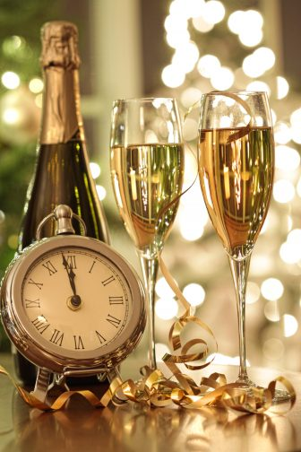 Champagne glasses and pocket watch ready to celebrate New Years Eve