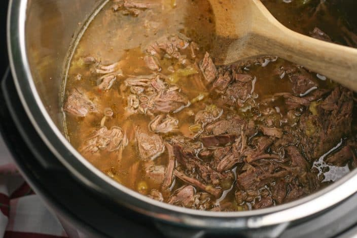 shredded roast beef in broth to make italian beef