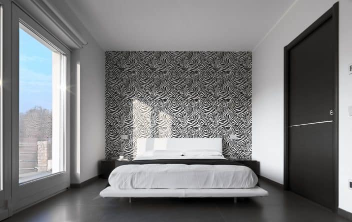 a bedroom with one wall of wallpaper that is black and white, great for home renovation