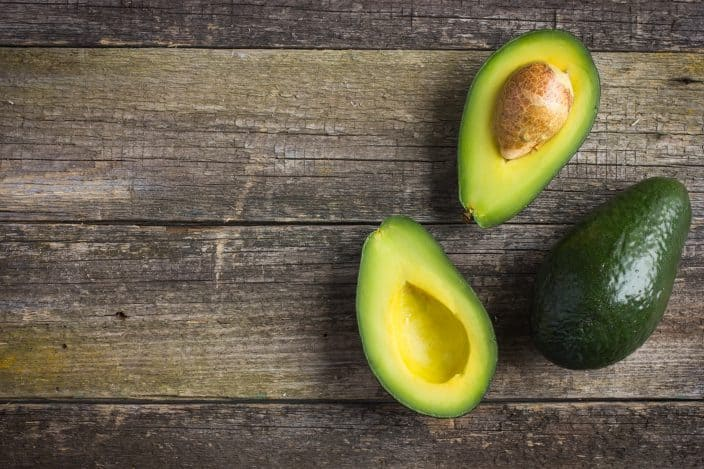 avocados on a wooden background