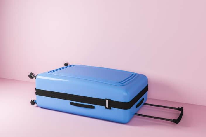 a blue carry-on suitcase