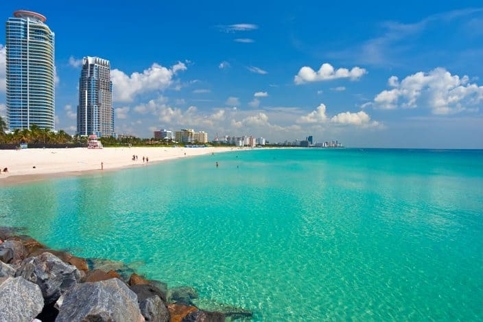 Florida beach with blue water, beach and highrises