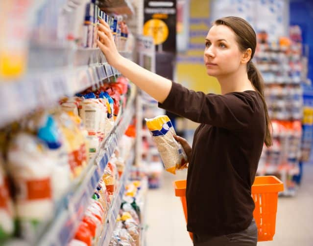 a woman shopping in the grocery store