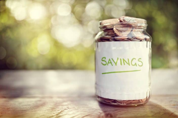 a jar with coins representing a savings account