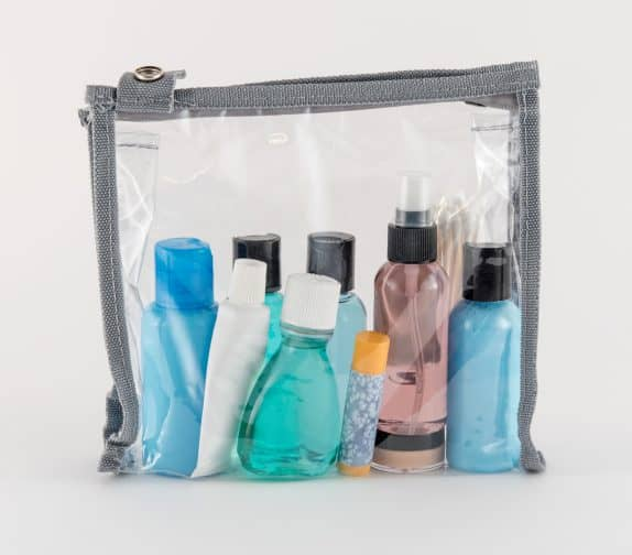 toiletries in a clear pouch for traveling