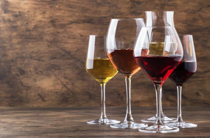 an assortment of wines in wine glasses which you can sample at wineries in Virginia