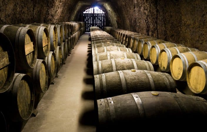 a wine cellar with barrels of wine inside