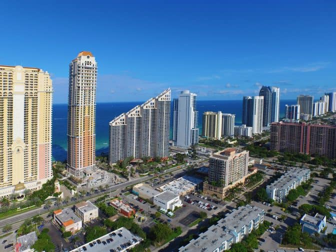 an aerial view of Sunny Isles beach high rises and the Acqualina resort, a top romantic getaway in Florida