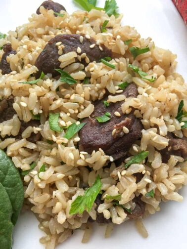 instant pot beef and rice close up on a white plate