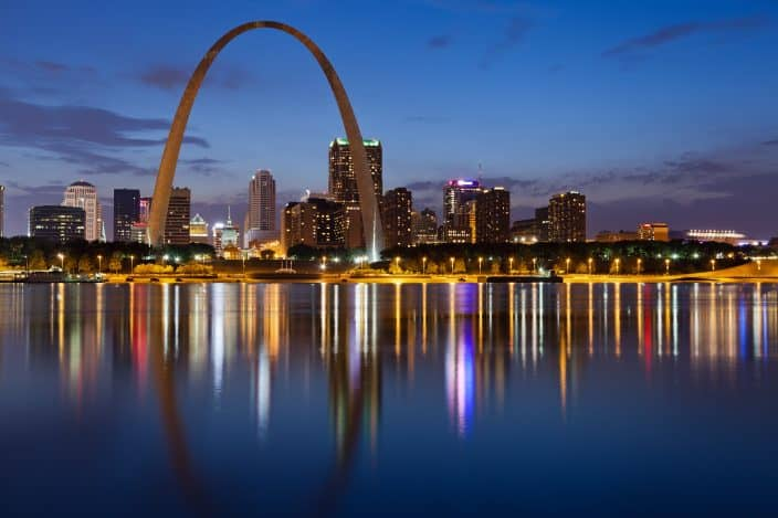 Image of St. Louis downtown with Gateway Arch at twilight, a romantic weekend getaway destination.