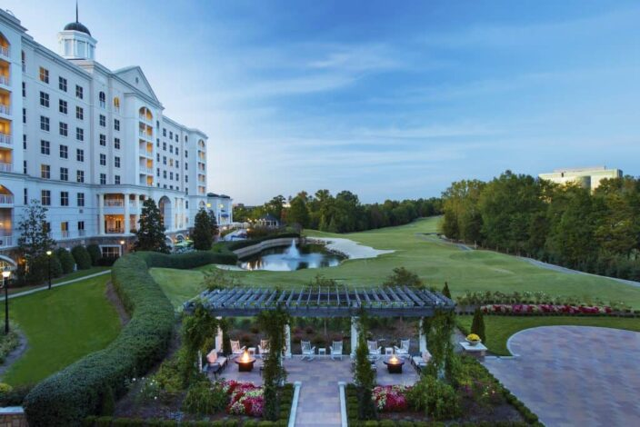 The rose garden and exterior of the Ballantyne Hotel in Charlotte, North Carolina